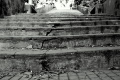 Strength / stairs. The world breaks everyone, and afterwards, some are strong at broken places.- Ernest Hemingway stock image