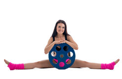 smiling flexible man posing in difficult yoga pose stock