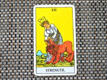 The Strength Tarot Card Brave Strong Self Confidence. The Strength Tarot Card makes you brave strong with inner strength. It is about Inner strength, self royalty free stock photo