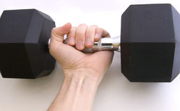 Strength training. Hand working itself to lift a barbell Stock Images