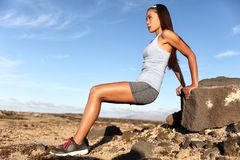 Strength training fitness woman working out arms. Muscles doing triceps dips. Asian athlete exercising with bodyweight exercises for toned body. Sun suntan royalty free stock photos
