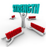 Strength Vs Weakness Person Lifting Word Strong. Strength word lifted by a strong or skilled person while the competition is crushed by weakness or lack of Royalty Free Stock Photo