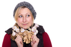 Strengthen the immune system. Standing in front of a white background with necklaces of garlic and ginger Stock Images