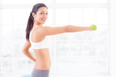 Strengthening her muscles. Stock Photo