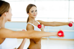 Strengthening her muscles. Royalty Free Stock Photography