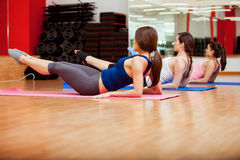 Strengthening their core at a gym Royalty Free Stock Photography