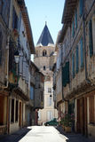 Streret and tower. SOREZE, FRANCE - CIRCA JULY 2015 Dtreet and Saint-Martin tower stock photos