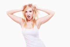 Stres. Młodej kobiety sfrustowany ciągnięcie jej włosy na bielu Fotografia Stock