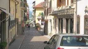Car in the narrow street. 20.06.2016 - Stresa, Italy. Car in the narrow street. Town, sunny day Safe driving tips for travelers stock video footage
