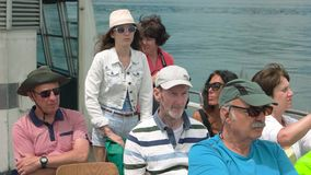 Group of tourists. 20.06.2016 - Stresa, Italy Group of tourists Woman on boat taking photos stock video