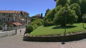 Hotel near the road. 20.06.2016 - Stresa, Italy. Hotel near the road. Summer nature and town buildings. Cheapest hotels in Europe stock video footage