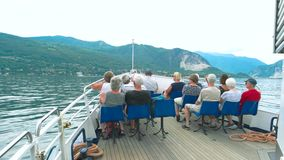 People on boat, Maggiore lake. 20.06.2016 - Stresa, Italy. People on boat, Maggiore lake. Tourists in Italy summer Best first-time Europe itineraries stock footage