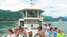 Tourists on a boat, summer. 20.06.2016 - Stresa, Italy. Tourists on a boat summer Cloudy sky over Maggiore lake stock video footage
