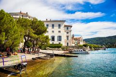 STRESA, PIEDMONT / ITALY - JULY 15, 2017: Isola Bella ferry port. Lakefront in Maggiore lake. The island is 320 metres long by 400 metres wide Royalty Free Stock Images