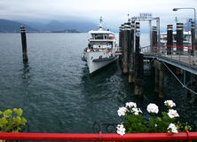 Stresa port. Leaving boat in Stresa port, landing stage and some frowers Stock Photography