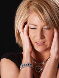 Stress. Young attractive model with a headache Royalty Free Stock Photos