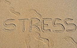 Stress. Word stress written in the sand on the beach Royalty Free Stock Photography