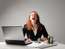 Stress. Nervous businesswoman screaming at the office Royalty Free Stock Photography