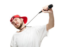 Stress. A young guy with a beard strangles himself microphone, isolated on white background Royalty Free Stock Image