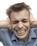 Stress. Man with severe headache or stressed from hard noise Stock Images