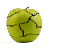 Stress. Green apple with cracks as concept for stress and illness Royalty Free Stock Image