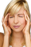 Stress. Young blond woman having a headache close up Royalty Free Stock Photography