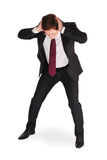Stress. Young man in business suit holding his head with hands with a panic expression. Isolated on white Royalty Free Stock Image