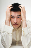 Stress. Young business man in stress close up shoot Royalty Free Stock Images