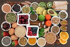 Stress and Anxiety Relieving Health Foods. Stress and anxiety relieving health food also with herbs and spice used in herbal medicine that help with relaxation royalty free stock photos