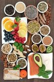 Stress and Anxiety Relieving Health Foods. Herbs, spices and supplement powders that also help relaxation and reduce chronic fatigue and depression. Top view royalty free stock photography