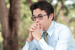 Stress. Asian man stress and hold the head with hand Royalty Free Stock Photos