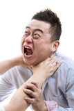 Stress. Asian man in shirt suffocated with isolated white background Royalty Free Stock Images
