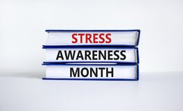 Free Stress Awareness Month Symbol. Books With Words `Stress Awareness Month`. Beautiful White Background. Psychological, Business An Royalty Free Stock Images - 213909009