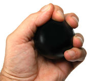 Stress ball. Hand squeezing a stress ball Royalty Free Stock Photo