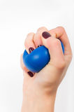 Stress ball. In hand on a white background Royalty Free Stock Photos