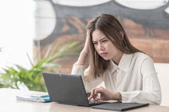 Stress business woman have problems and worried. Young asian woman attractive sad and desperate businesswoman suffering stress and headache at office laptop Royalty Free Stock Images