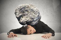 Stress of a businessman. With a big rock Stock Image