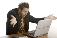 Stress of businessman because of computer crash Stock Photography