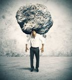 Stress of a businessman. Concept of stress of a businessman with a big rock Stock Images