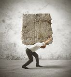 Stress of a businessman. Concept of stress of a businessman with a big rock Stock Photography