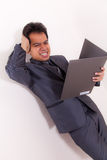 Stress Businessman With Folio. Stress Asian young Businessman With Folio Royalty Free Stock Images