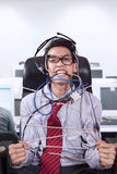 Stress businessman tied in rope at office Royalty Free Stock Image