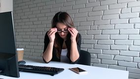 Stress. Businesswoman looks devastated while having problems with work stock video footage
