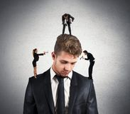 Stress. Concept of stressed men due to colleagues Stock Photos