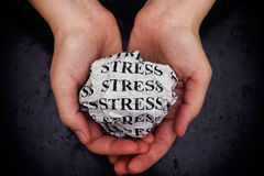 Stress. Crumpled paper ball with word Stress in woman hands. Closeup Royalty Free Stock Image