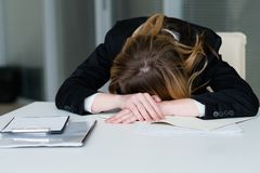 Stress deadline overworking exhausted woman desk Royalty Free Stock Photography
