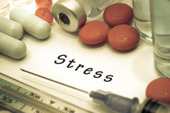 Stress. Diagnosis written on a white piece of paper. Syringe and vaccine with drugs Stock Images