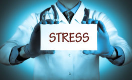 Stress. Doctor keeps a card with the name of the diagnosis – stress. Selective focus. Medical concept Royalty Free Stock Images