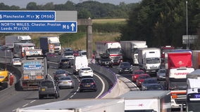 M6 motorway traffic moving slowly looking through wire mesh 4K. Stress of driving in England M6 motorway England UK 4K stock video