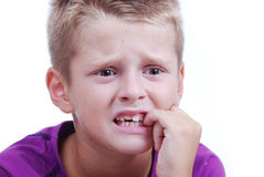 Stress expression on little blond kid's face Royalty Free Stock Photography